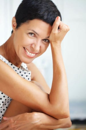 Woman smiling after a Skincare procedure