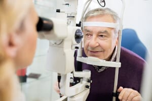Elderly man having an eye exam
