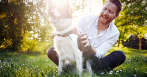 Man with dry eyes outside with his dog