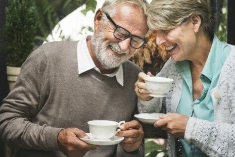Older couple celebrating after dry eye treatment