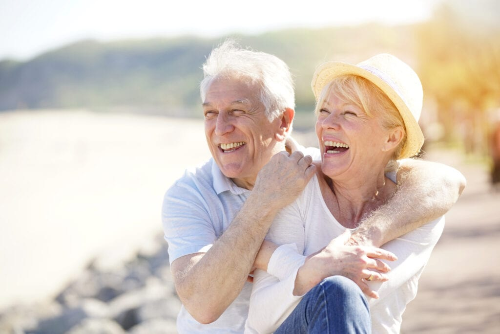 Older couple laughing after dry eye treatment